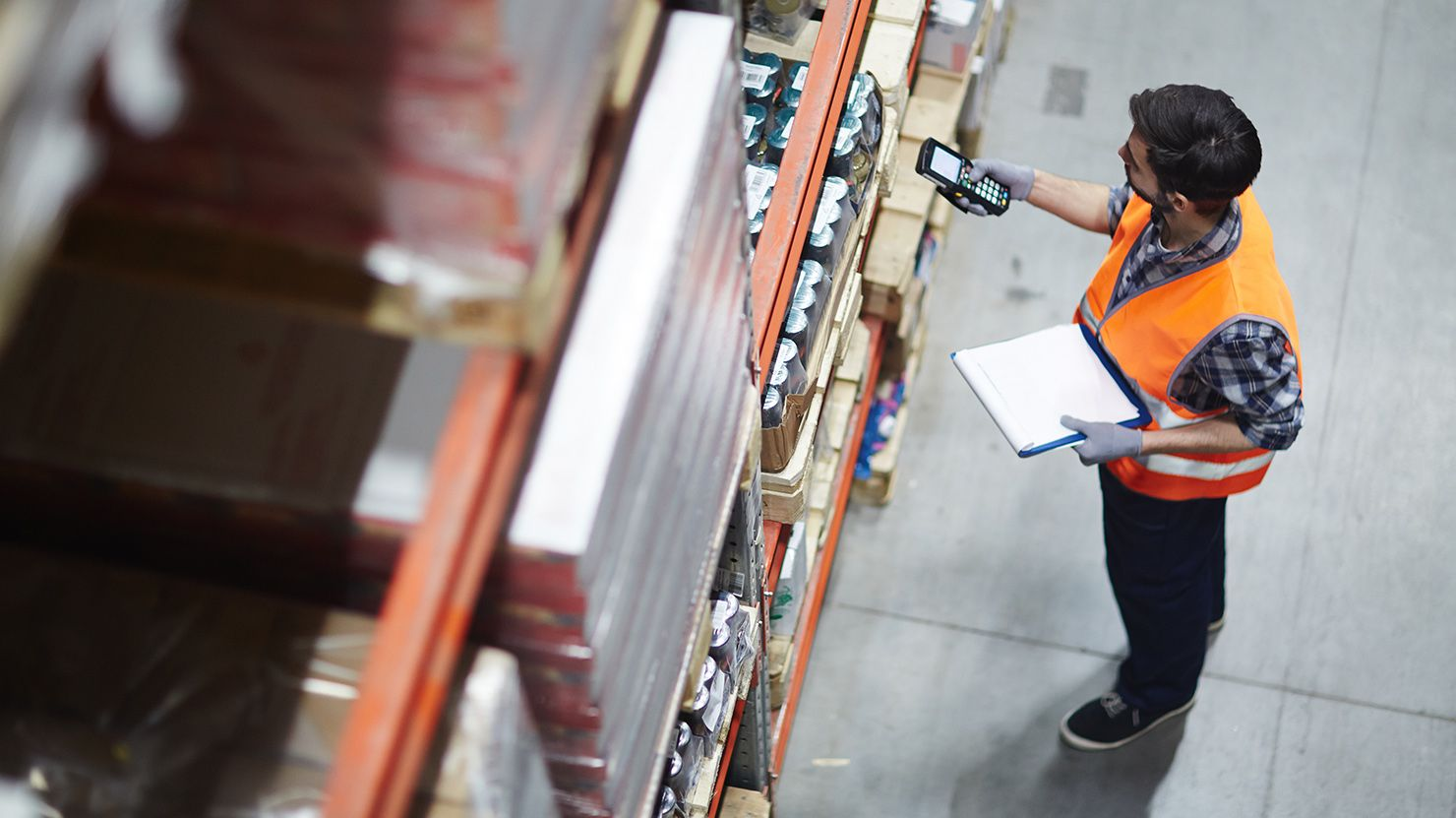 view from above of man doing inventory in warehouse